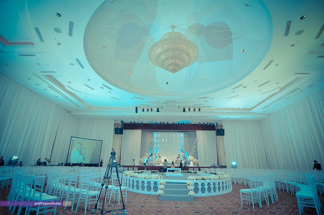all white chairs, round stage
