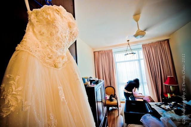 dress hung on cupboard, closet,