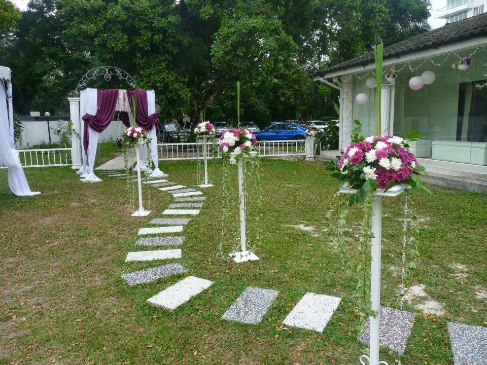 flower stands purple door way