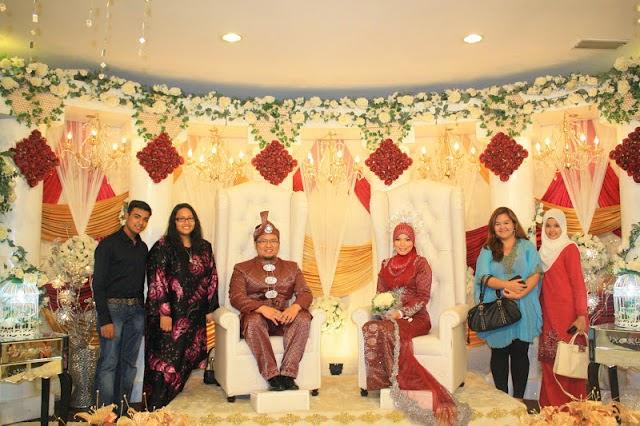 red ketupat groom bride in red