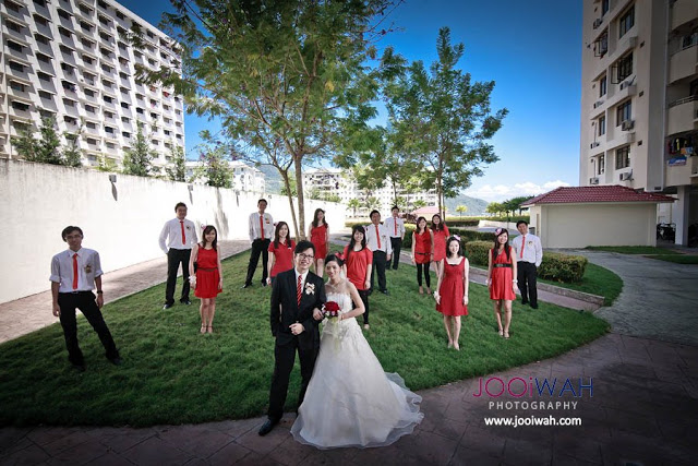 red bridemaids and groomsmen with red tie