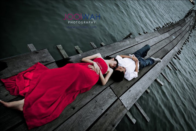 lying on the jetty with dramatic background of rough sea