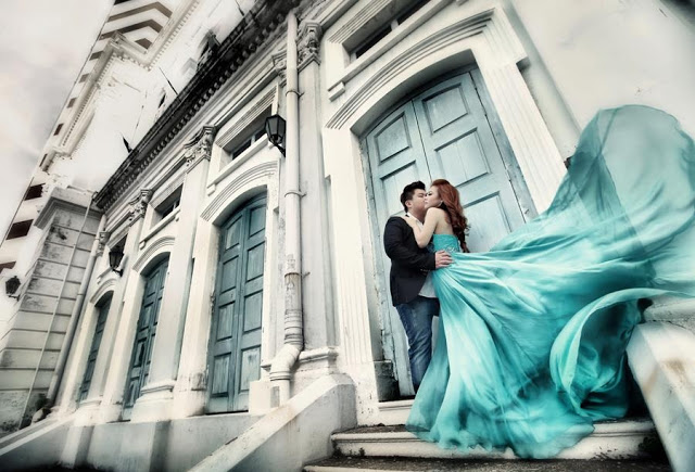 flying wedding dress in blue,