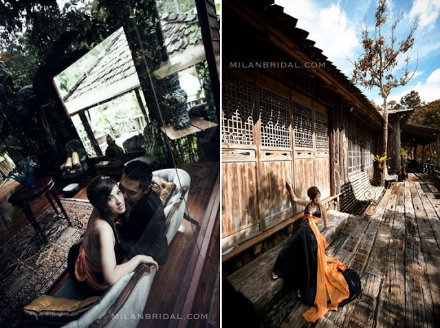 bride looking at camera wooden house