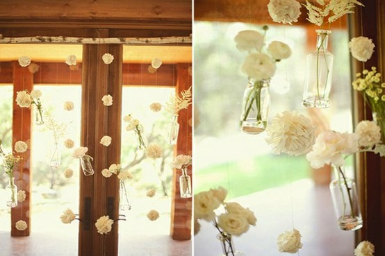 dangling flowers in bottles
