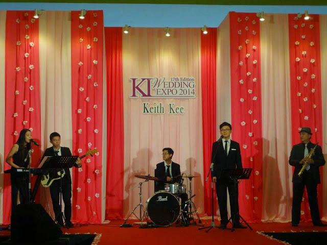 performers in black formal wear suit