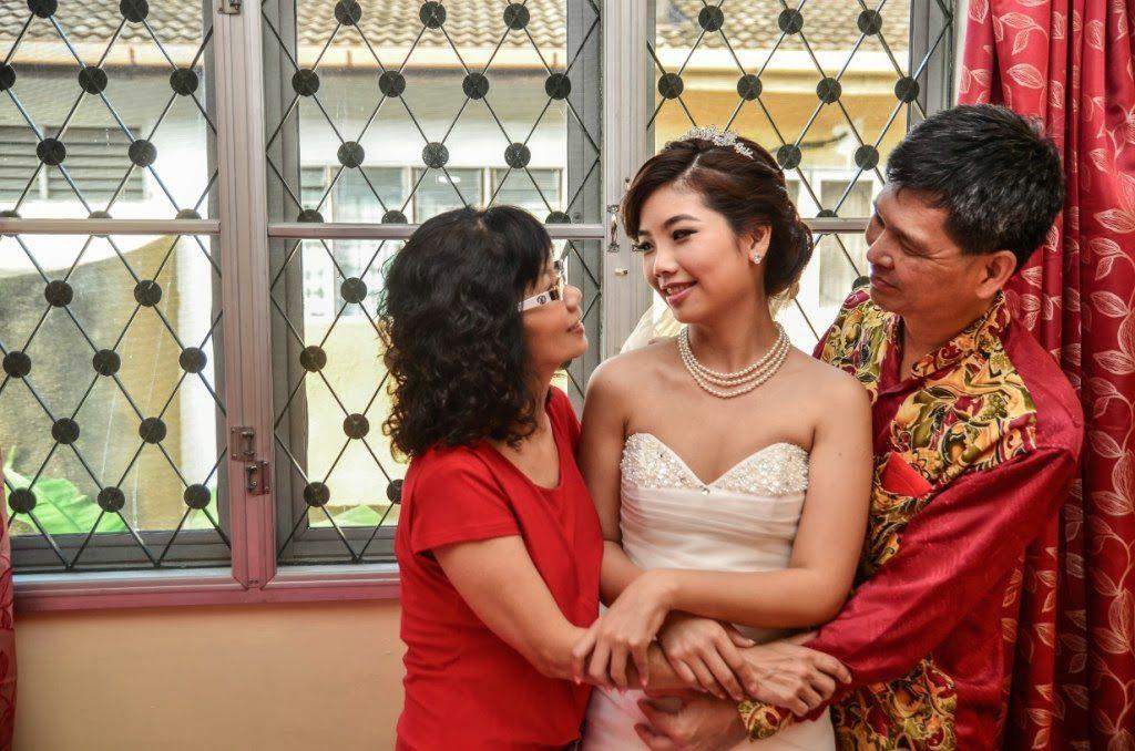 parents hugging bride