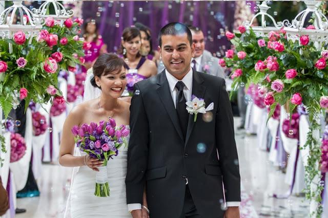 holding bouquet purple shades flowers KL