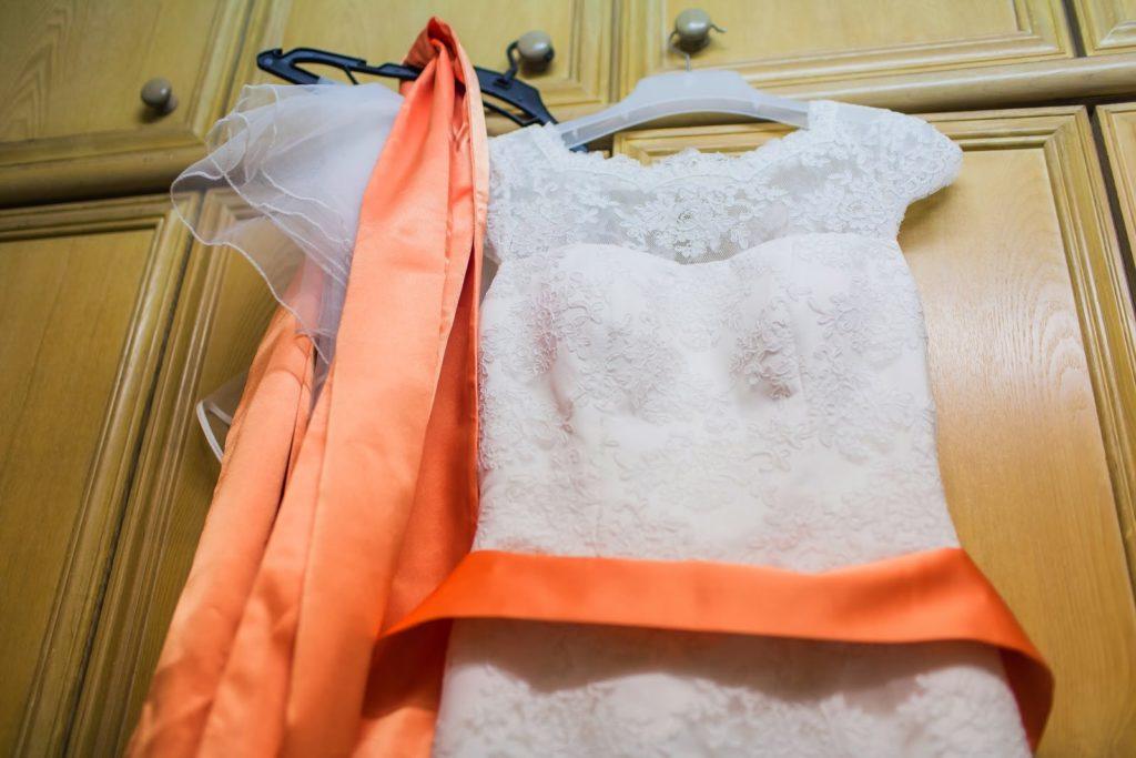 orange sash white gown