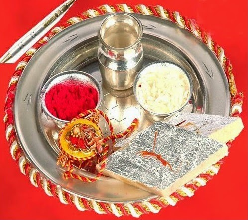 metal tray wtih red rice grains for prayer