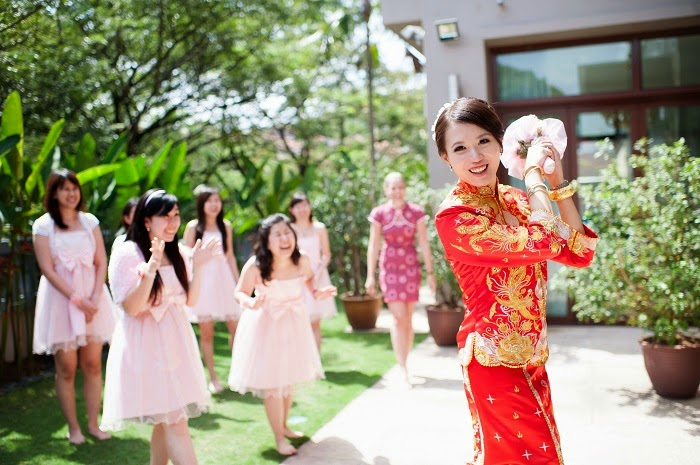 getting ready to toss bride in red